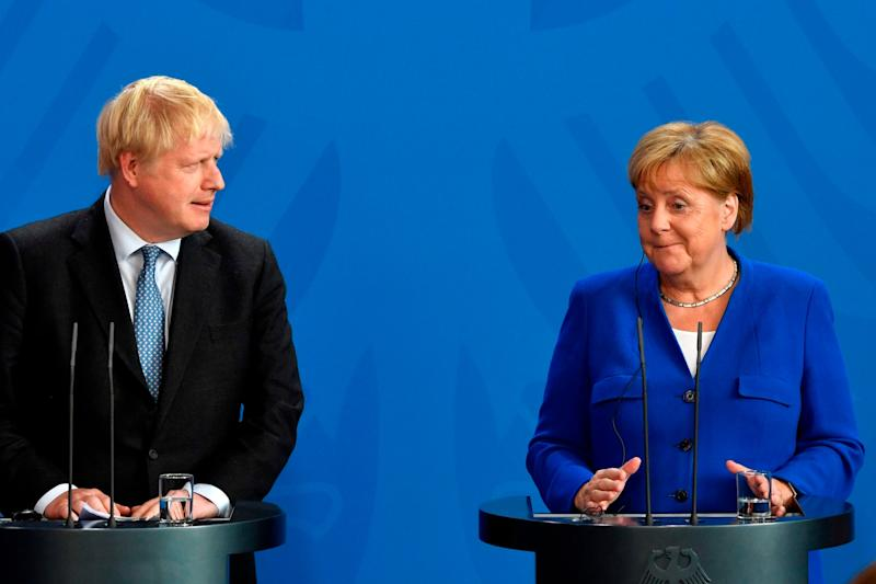 Boris Johnson and Angela Merkel (AFP/Getty Images)