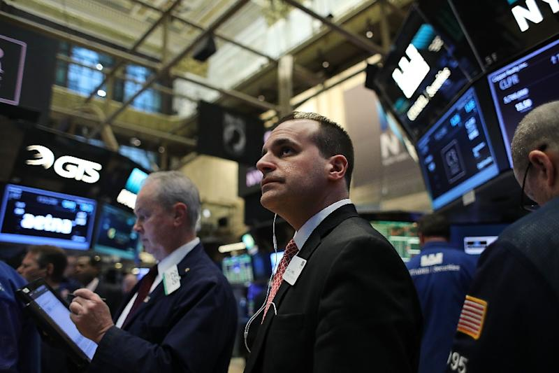Trading got underway at Wall Street with investors awaiting any specifics on fiscal stimulus and tax cuts in President Donald Trump address to a joint session of Congress (AFP Photo/SPENCER PLATT)