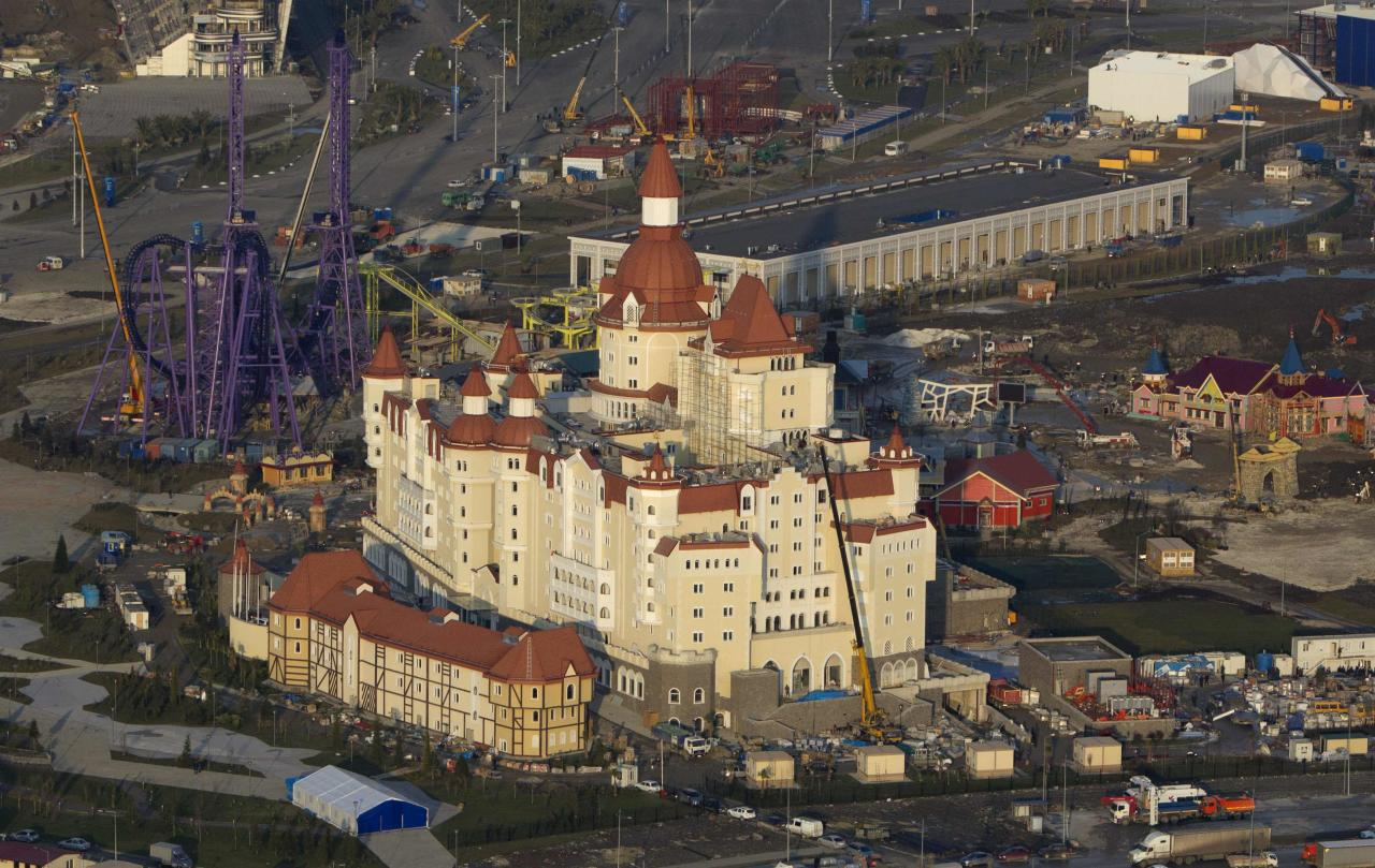 """An aerial view from a helicopter shows the """"Theme Park / Amusement Park"""" (back) constructed by the JSC """"Sochi Park"""" company in the Adler district of the Black Sea resort city of Sochi, December 23, 2013. Sochi will host the 2014 Winter Olympic Games in February. Picture taken December 23, 2013. REUTERS/Maxim Shemetov (RUSSIA - Tags: CITYSCAPE BUSINESS CONSTRUCTION SPORT OLYMPICS TRAVEL)"""