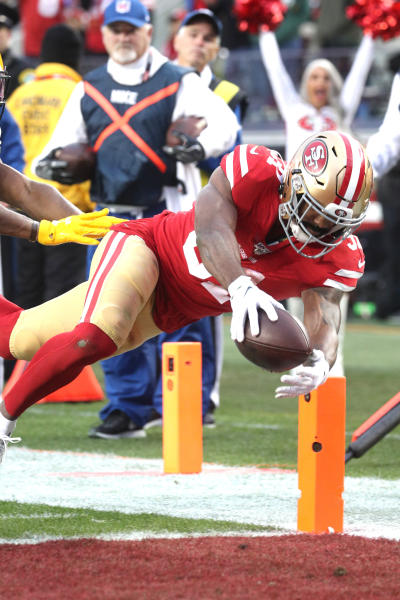 San Francisco 49ers running back Raheem Mostert (31) dives over the goal line for a touchdown during the NFL NFC Championship football game against the Green Bay Packers, Sunday, Jan. 19, 2020 in Santa Clara, Calif. The 49ers defeated the Packers 37-20 (Margaret Bowles via AP)