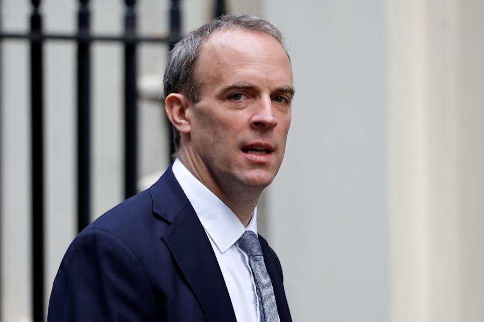 Britain's Foreign Secretary Dominic Raab arrives at 10 Downing Street in central London on November 26, 2020. - Britain's government on Wednesday unveiled plans to slash the foreign aid budget to help mend its coronavirus-battered finances, prompting one minister to quit and defying impassioned calls to protect the world's poorest people. (Photo by Tolga Akmen / AFP) (Photo by TOLGA AKMEN/AFP via Getty Images)