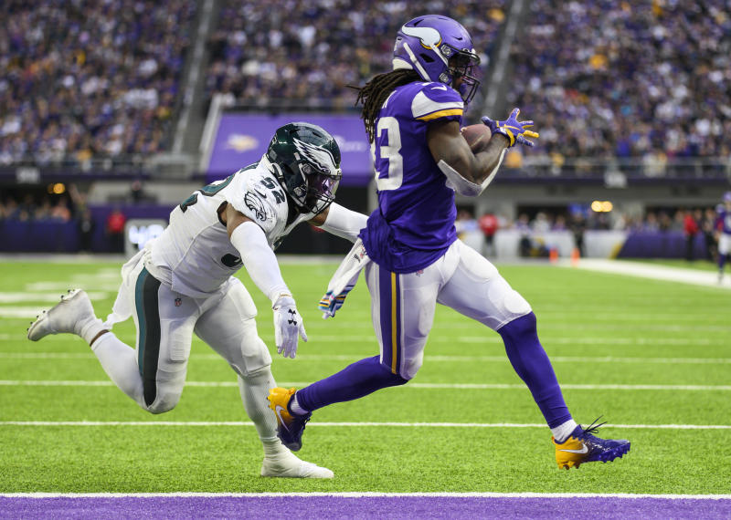 MINNEAPOLIS, MN - OCTOBER 13: Dalvin Cook #33 of the Minnesota Vikings runs with the ball for a one yard touchdown in the fourth quarter of the game against the Philadelphia Eagles at U.S. Bank Stadium on October 13, 2019 in Minneapolis, Minnesota. (Photo by Stephen Maturen/Getty Images)