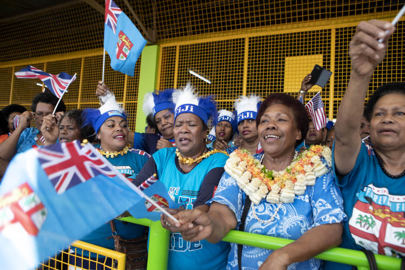 Local Fijian women wait for the arrival of Meghan, Duchess of Sussex at a market in Suva, Fiji, Wednesday, Oct. 24, 2018. Prince Harry and his wife Meghan are on day nine of their 16-day tour of Australia and the South Pacific. (Ian Vogler/Pool Photo via AP)