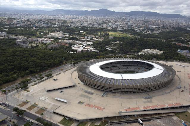FILE - In this This Feb. 7, 2014, file photo, released by Portal da Copa shows an aerial view of Mineirao stadium in Belo Horizonte, Brazil. Twelve stadiums in 12 cities will host World Cup soccer matches. (AP Photo/Marcus Desimoni, Portal da Copa, File)