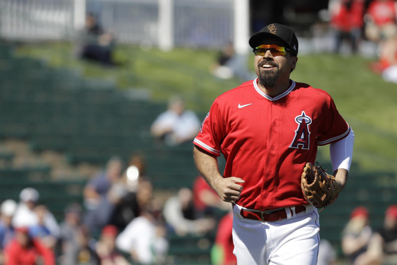 Los Angeles Angels' Anthony Rendon smiles as he runs to the dugout during the first inning of a spring training baseball game against the Cincinnati Reds, Tuesday, Feb. 25, 2020, in Tempe, Ariz. (AP Photo/Darron Cummings)