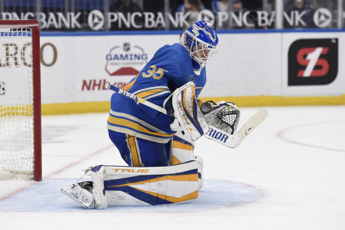 St. Louis Blues' Ville Husso (35) blocks a shot from the Minnesota Wild during the third period of an NHL hockey game on Saturday, April 10, 2021, in St. Louis. (AP Photo/Joe Puetz)