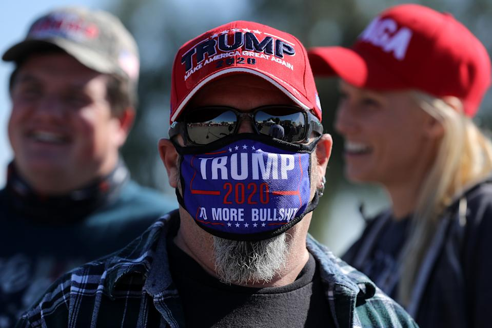GOODYEAR, ARIZONA - OCTOBER 28: A supporter of U.S. President Donald Trump waits in line to attend a campaign rally with Trump at Phoenix Goodyear Airport October 28, 2020 in Goodyear, Arizona. With less than a week until Election Day, Trump and his opponent, Democratic presidential nominee Joe Biden, are campaigning across the country. (Photo by Chip Somodevilla/Getty Images)
