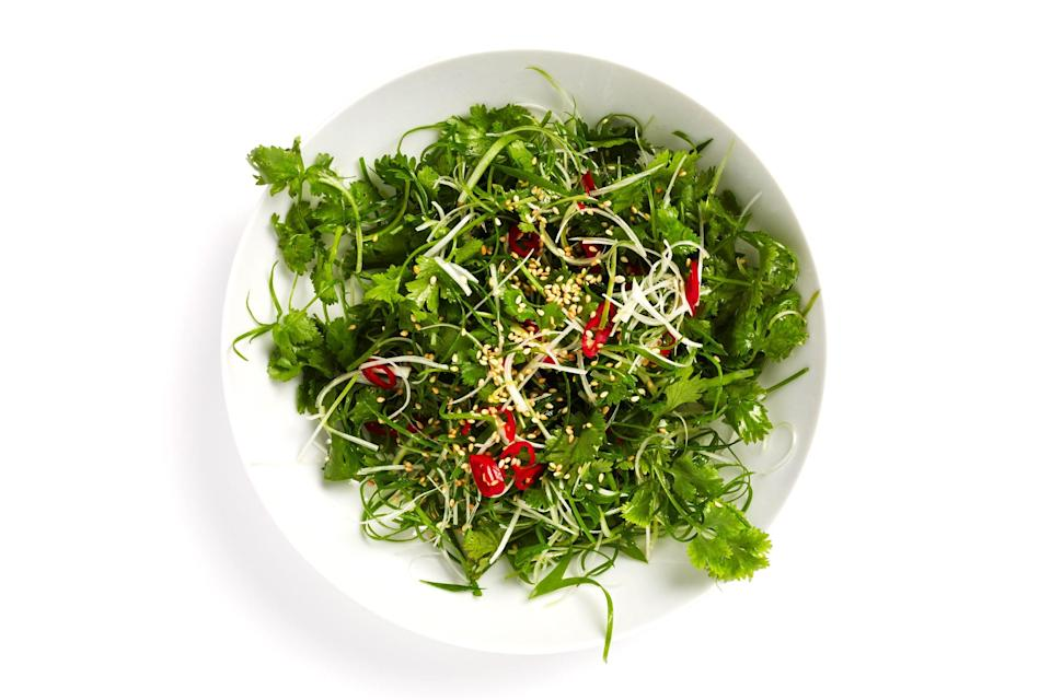 """Slicing the scallion greens and chile at an extreme diagonal makes for a pleasing presentation. <a href=""""https://www.bonappetit.com/recipe/scallion-salad?mbid=synd_yahoo_rss"""" rel=""""nofollow noopener"""" target=""""_blank"""" data-ylk=""""slk:See recipe."""" class=""""link rapid-noclick-resp"""">See recipe.</a>"""