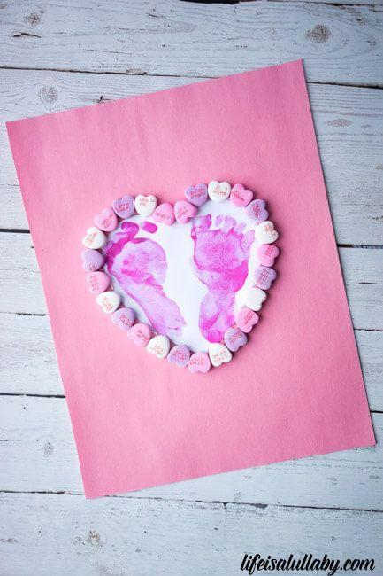 """<p>Parents, grandparents, close relatives, and godparents will cherish this personalized card for years to come. </p><p><em><a href=""""https://www.thebestideasforkids.com/footprint-heart-craft/"""" rel=""""nofollow noopener"""" target=""""_blank"""" data-ylk=""""slk:Get the tutorial at The Best Ideas for Kids »"""" class=""""link rapid-noclick-resp"""">Get the tutorial at The Best Ideas for Kids »</a></em></p>"""
