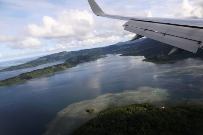 FILE PHOTO: U.S. Secretary of State Pompeo's plane makes a landing approach at Pohnpei International Airport in Kolonia, Federated States of Micronesia