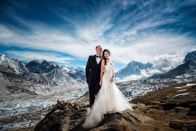 James Sissom and Ashley Schmieder took their vows at Mount Everest base camp wearing a tux and wedding dress. (Photo: Charleton Churchill/Caters News)