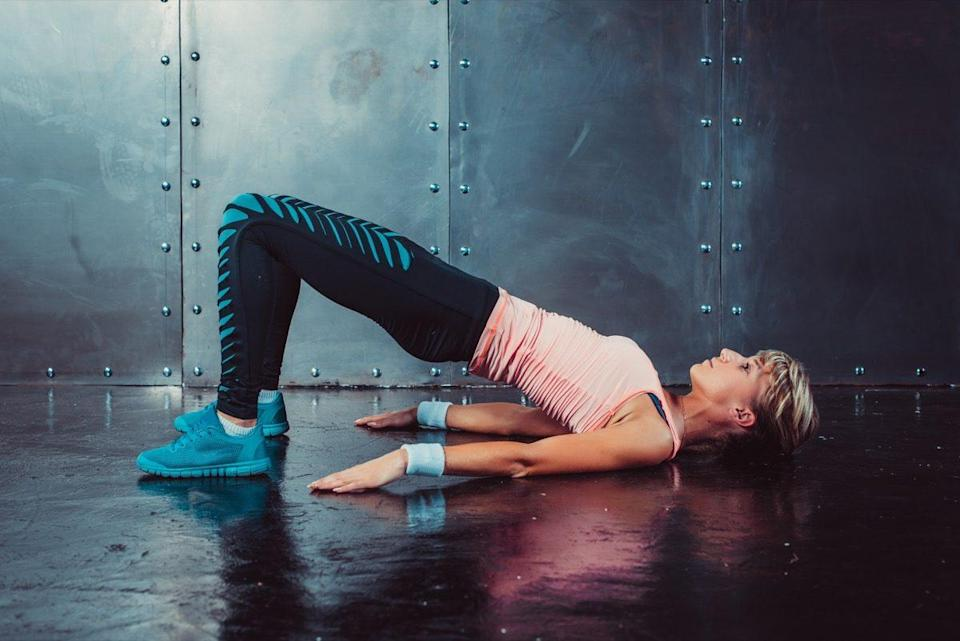 woman doing fitness workout yoga stretching gymnastics exercise