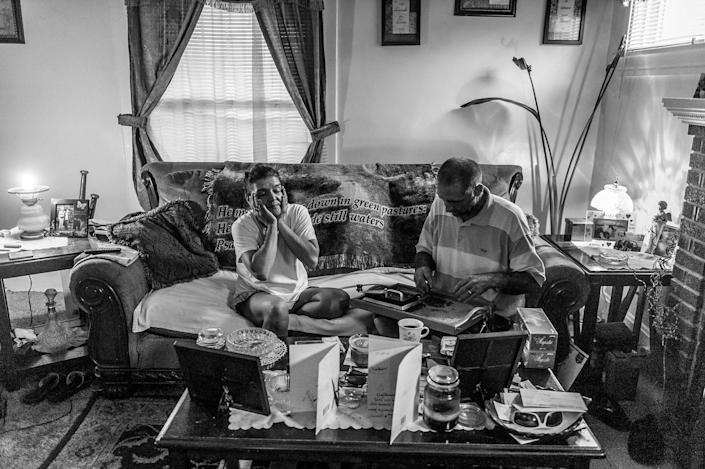 <p>Terri Fugate and her fiancé, Gene Robinson — is a a recovering heroin addict. An electrician, Gene prepares to head out for a job. (Photograph by Mary F. Calvert for Yahoo News) </p>