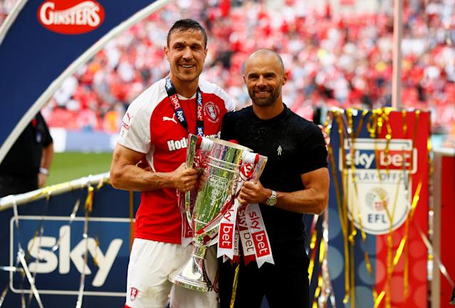 "Soccer Football - League One Play-Off Final - Rotherham United v Shrewsbury Town - Wembley Stadium, London, Britain - May 27, 2018 Rotherham manager Paul Warne and Richard Wood celebrate winning the League One Play-Off Final with the trophy Action Images/Jason Cairnduff EDITORIAL USE ONLY. No use with unauthorized audio, video, data, fixture lists, club/league logos or ""live"" services. Online in-match use limited to 75 images, no video emulation. No use in betting, games or single club/league/player publications. Please contact your account representative for further details."
