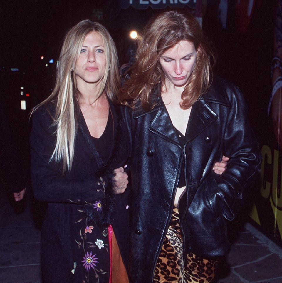 <p>Jennifer Aniston and a friend arrive at the grand re-opening of the Viper Room on January 9, 1999.</p>