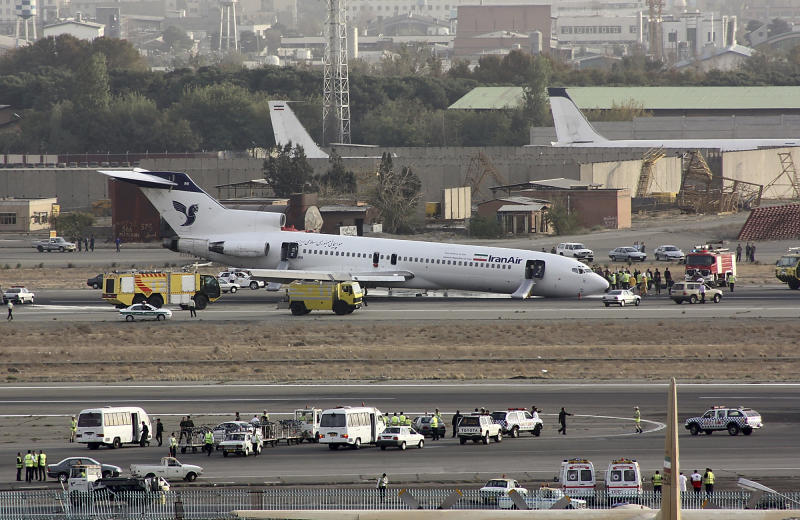 In this Tuesday, Oct. 18, 2011 photo, an Iran Air Boeing 727 landed on its nose, after the landing gear jammed, at the Mehrabad airport in Tehran, Iran. Captain Hooshang Shahbazi, an Iranian pilot who guided the Iran Air Boeing passenger plane to a safe emergency landing has launched an individual campaign to lift Western sanctions that restrict the import of civilian plane spare parts. (AP Photo/Hamid Reza Jafari)