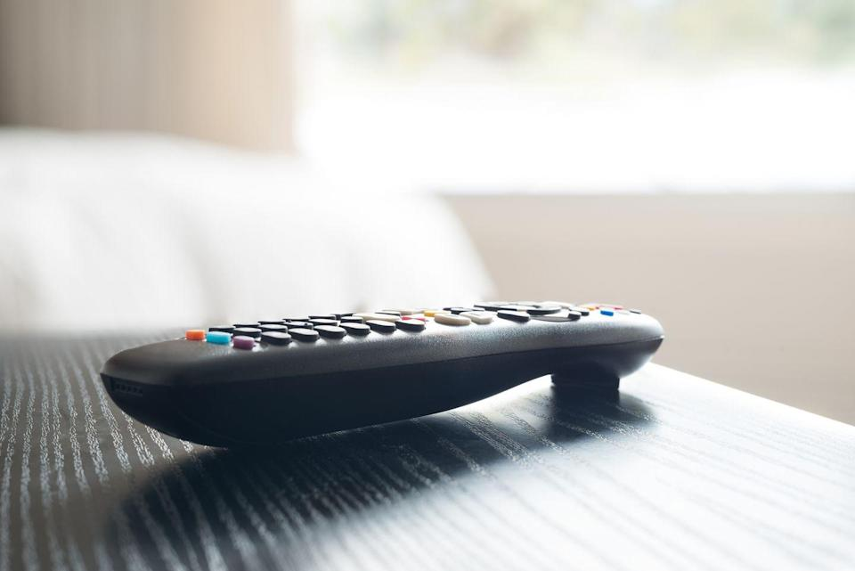 """<p>As one of the most fought-over gadgets in your home, remotes can be as bacteria-laden as toilet handles! """"Carefully de-gunk the buttons with a toothpick, and then swab the remote all over with a disinfecting wipe,"""" says Jennings in <a href=""""https://www.amazon.com/Good-Housekeeping-Simple-Organizing-Wisdom/dp/1618372785"""" rel=""""nofollow noopener"""" target=""""_blank"""" data-ylk=""""slk:Simple Organizing Wisdom"""" class=""""link rapid-noclick-resp""""><em>Simple Organizing Wisdom</em></a>. Designate a drawer or bin for your remotes-and make it a rule to return them to that spot when you turn off the TV, she says.</p>"""