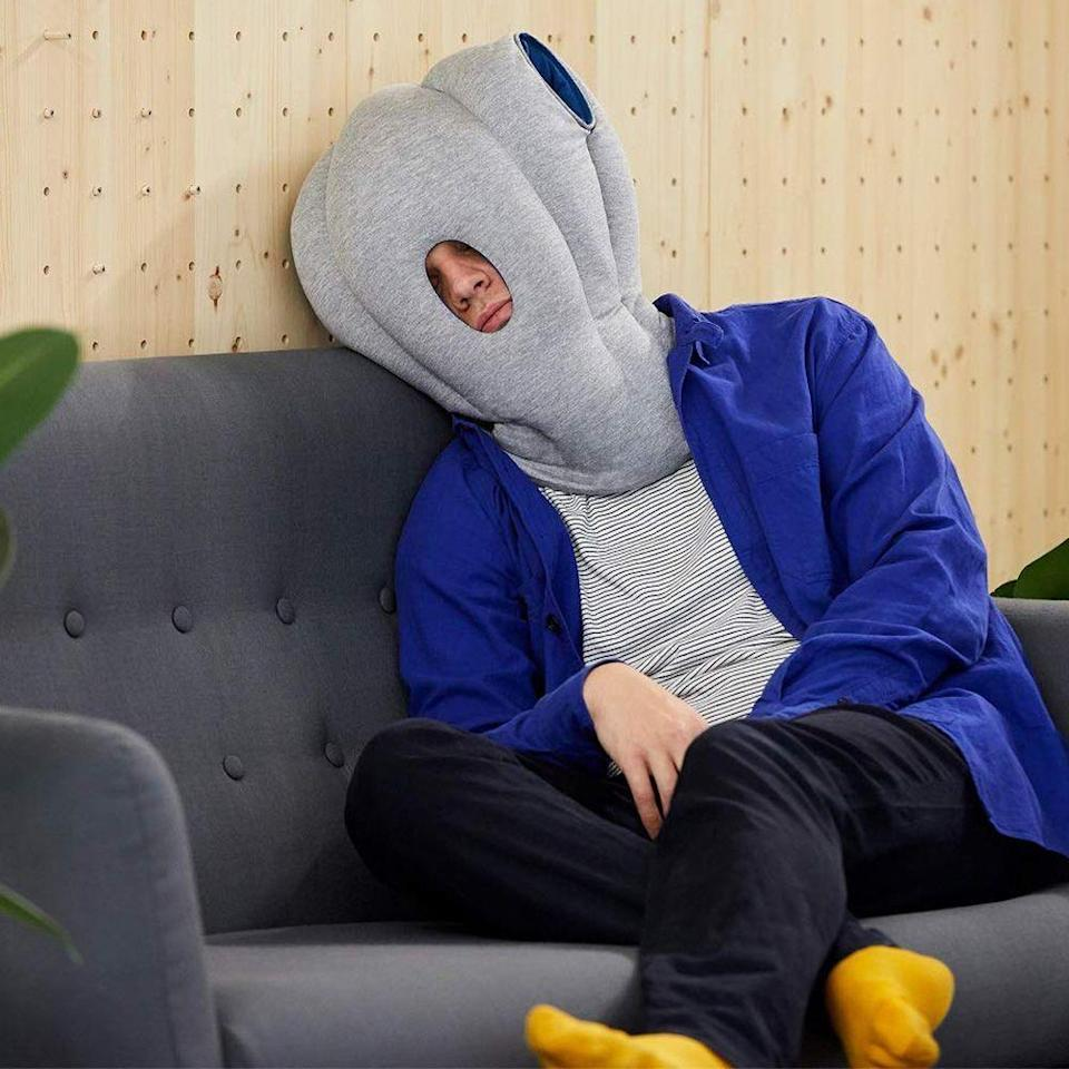 "<p><strong>OSTRICH PILLOW</strong></p><p>amazon.com</p><p><strong>$99.00</strong></p><p><a href=""https://www.amazon.com/dp/B00B4S6SLW?tag=syn-yahoo-20&ascsubtag=%5Bartid%7C2089.g.2149%5Bsrc%7Cyahoo-us"" rel=""nofollow noopener"" target=""_blank"" data-ylk=""slk:Shop Now"" class=""link rapid-noclick-resp"">Shop Now</a></p><p>You can nap anywhere (and we mean <em>anywhere</em>) with the Ostrich Pillow. Whether you're trying to catch some zzz's in the break room or are trying to forget you're on a <a href=""https://www.bestproducts.com/lifestyle/g30392222/top-travel-essentials/"" rel=""nofollow noopener"" target=""_blank"" data-ylk=""slk:long flight"" class=""link rapid-noclick-resp"">long flight</a>, you'll be able to sleep comfortably.</p>"