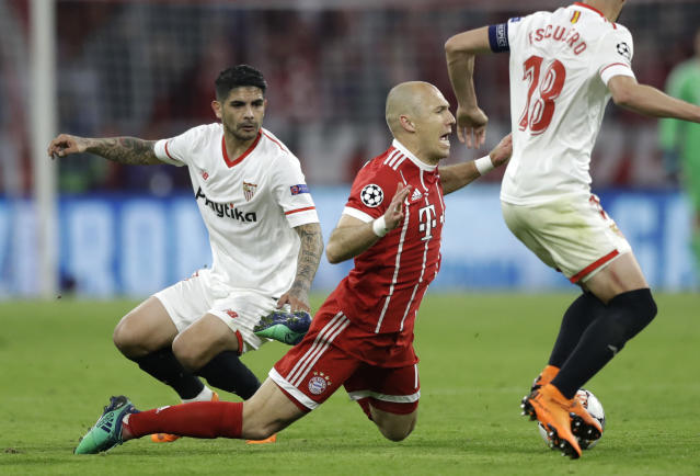 Bayern's Arjen Robben falls during the Champions League quarter final second leg soccer match between FC Bayern Munich and Sevilla FC at the Allianz Arena stadium in Munich, Germany, Wednesday, April 11, 2018. (AP Photo/Matthias Schrader)