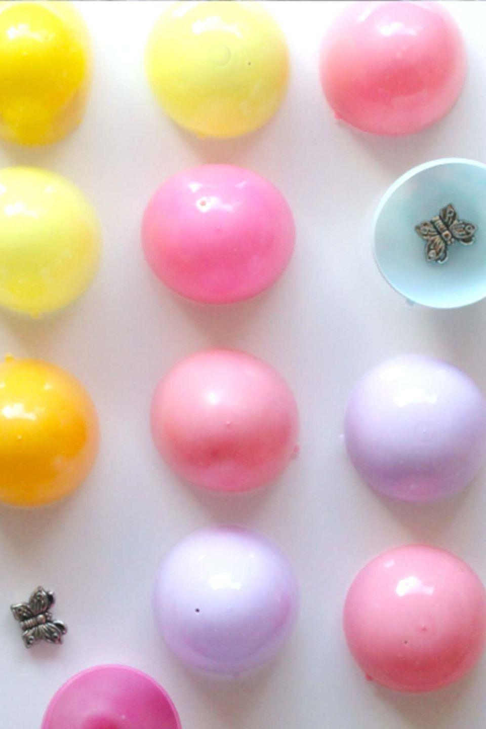 """<p>Hide tiny objects underneath your leftover plastic eggs in this fun memory game. </p><p><em>Get the tutorial at <a href=""""http://happilyevermom.com/easter-game-kids/"""" rel=""""nofollow noopener"""" target=""""_blank"""" data-ylk=""""slk:Happily Ever Mom"""" class=""""link rapid-noclick-resp"""">Happily Ever Mom</a>.</em></p>"""