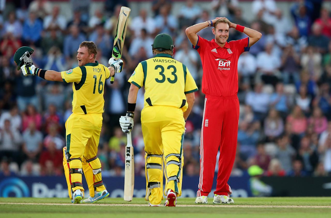 SOUTHAMPTON, ENGLAND - AUGUST 29:  Aaron Finch of Australia celebrates his century as Stuart Broad of England looks on during the 1st NatWest Series T20 match between England and Australia at Ageas Bowl on August 29, 2013 in Southampton, England.  (Photo by Julian Finney/Getty Images)