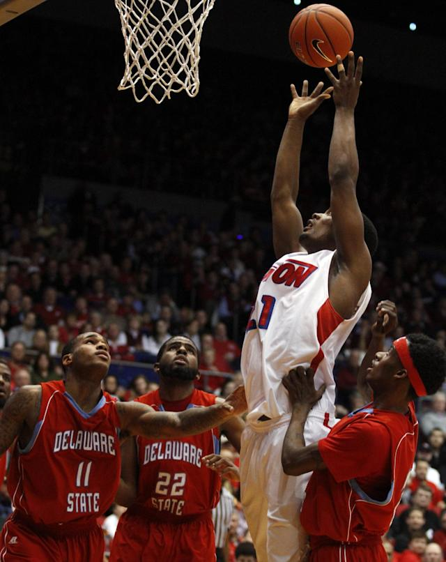 Dayton's Dyshawn Pierre (21) grabs an uncontested rebound against Delaware State in the first half of an NCAA college basketball game on Wednesday, Dec. 4, 2013, in Dayton, Ohio. (AP Photo/Skip Peterson)