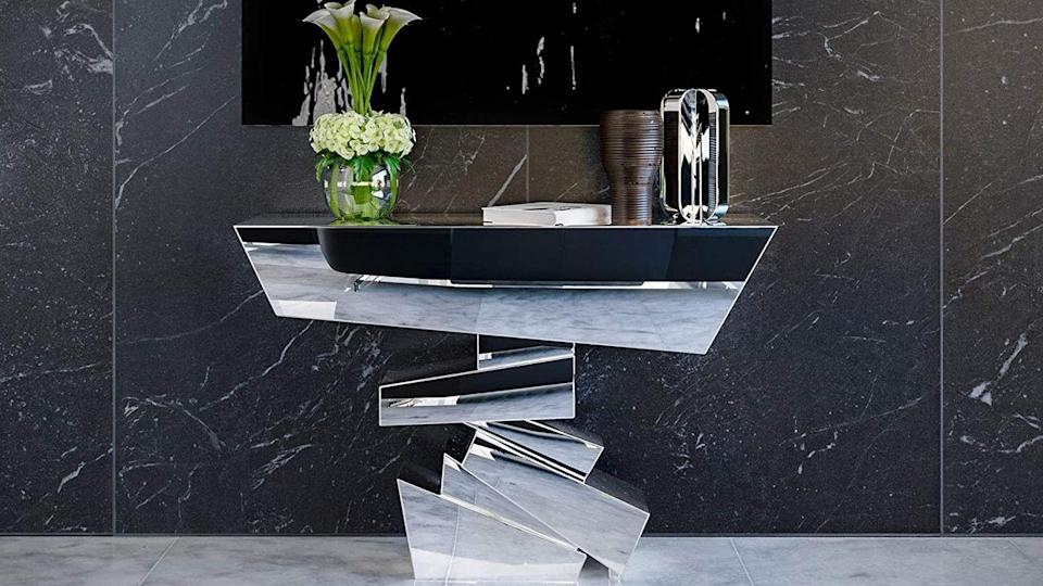 """<p>This <a href=""""https://www.amazon.com/Naxos-Glass-Mirrored-Console-Table/dp/B00DWZB94Q/ref=sr_1_12?dchild=1&keywords=Zuri+Furniture&qid=1633406525&sr=8-12&tag=syn-yahoo-20&ascsubtag=%5Bartid%7C10067.g.37858770%5Bsrc%7Cyahoo-us"""" rel=""""nofollow noopener"""" target=""""_blank"""" data-ylk=""""slk:Naxos Glass Mirrored Console Table"""" class=""""link rapid-noclick-resp"""">Naxos Glass Mirrored Console Table</a> could be used for its intended purpose as a table, but it's equally suitable as a stand alone sculpture. Fashion forward Amazon brand Zuri offers styles ranging from futuristic bed frames to ergonomic office chairs. </p><p><a class=""""link rapid-noclick-resp"""" href=""""https://www.amazon.com/s?k=Zuri+Furniture&ref=bl_dp_s_web_7071218011&tag=syn-yahoo-20&ascsubtag=%5Bartid%7C10067.g.37858770%5Bsrc%7Cyahoo-us"""" rel=""""nofollow noopener"""" target=""""_blank"""" data-ylk=""""slk:Shop Zuri on Amazon"""">Shop Zuri on Amazon</a></p>"""