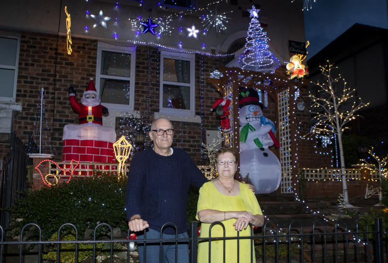 Christmas lights are up on the home of Ian and Helen Cochran in Hamilton (Picture: SWNS)