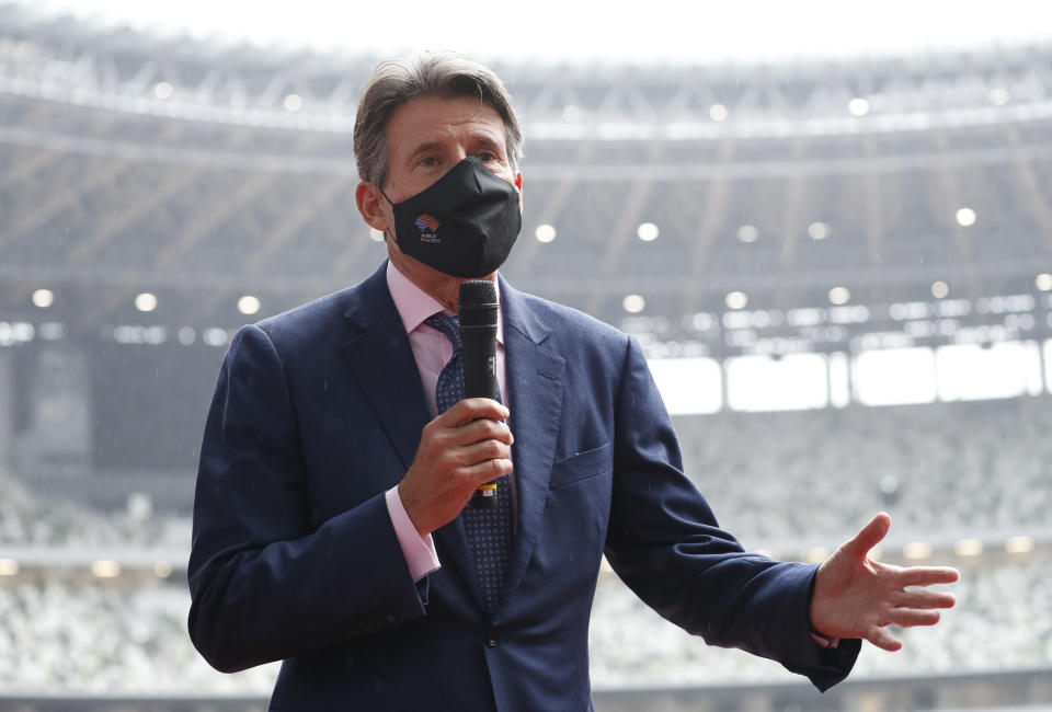 FILE - In this Oct. 8, 2020, file photo, World Athletics President Sebastian Coe, wearing a protective face mask, speaks to media as he inspects at the National Stadium, the main stadium of the Tokyo 2020 Olympic and Paralympic Games, in Tokyo. With no Usain Bolt on the track and no fans in the stadium, Coe still believes his sport is in good shape heading into the track and field program at the Tokyo Olympics. (Issei Kato/Pool Photo via AP, File)