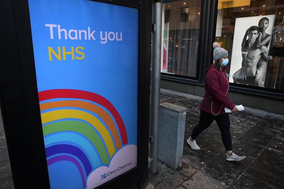 Embargoed to 2330 Thursday January 28 File photo dated 12/01/21 of a person walking past a 'thank you NHS' sign. The NHS is