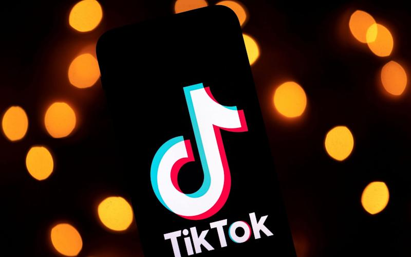 This file photo taken on November 21, 2019 shows the logo of the social media video sharing app Tiktok displayed on a tablet screen in Paris. Microsoft announced on August 2, 2020 it would continue talks to acquire the US operations of popular video-sharing app TikTok, after meeting with President Donald Trump who seemingly backed off his earlier threats to ban the Chinese-owned platform - Lionel Bonadventure/AFP/Getty