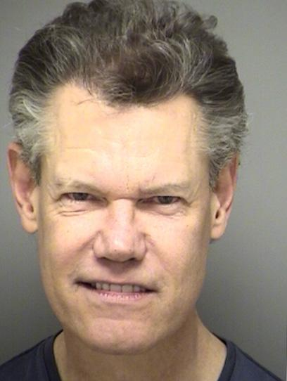 DENTON, TX - FEBRUARY 06:  In this handout image provided by the Denton County Sheriff's Office, country musician Randy Travis is seen in a booking photo February 6, 2012 in Denton, Texas.  Travis was arrested in Sanger, Texas for public intoxication, cited and later released.  (Photo by Denton County Sheriff's Office via Getty Images)