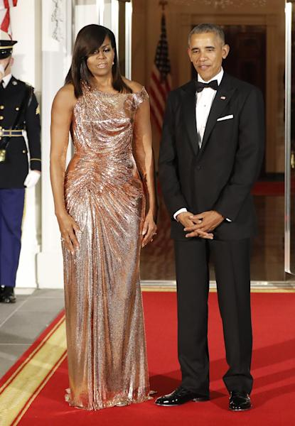 President Barack Obama and first lady Michelle Obama as they wait to greet Italian Prime Minister Matteo Renzi and his wife Agnese Landini on the North Portico for a State Dinner at the White House in Washington, Tuesday, Oct. 18, 2016. (AP Photo/Pablo Martinez Monsivais)