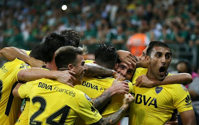Soccer Football - Palmeiras v Boca Juniors - Copa Libertadores - Allianz Parque Stadium, Sao Paulo, Brazil - April 11, 2018. Carlos Tevez (2nd R) of Argentina's Boca Juniors is embraced by teammates after scoring a goal. REUTERS/Paulo Whitaker