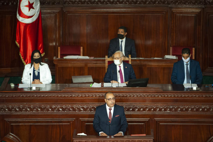 Tunisian designated Prime Minister Hichem Mechichi, center below, delivers his speech at the parliament before a confidence vote in Tunis, Tuesday, Sept. 1, 2020. (AP Photo/Riadh Dridi)