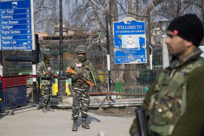 Indian paramilitary soldiers stand guard near a temporary check point during a strike in Srinagar, Indian controlled Kashmir, Sunday, Feb. 3, 2019. India's prime minster is in disputed Kashmir for a daylong visit Sunday to review development work as separatists fighting Indian rule called for a shutdown in the Himalayan region. (AP Photo/Dar Yasin)