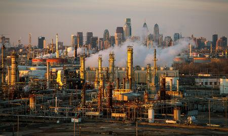 FILE PHOTO: The Philadelphia Energy Solutions oil refinery is seen at sunset in front of the Philadelphia skyline March 24, 2014. REUTERS/David M. Parrott/File Photo