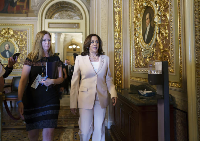 Vice President Kamala Harris arrives at the Senate to break any tie votes as the Senate prepares to hold a procedural vote on infrastructure, at the Capitol in Washington, Wednesday, July 21, 2021. Republicans are prepared to block the vote by mounting a filibuster over what they see as a rushed and misguided process. (AP Photo/J. Scott Applewhite)