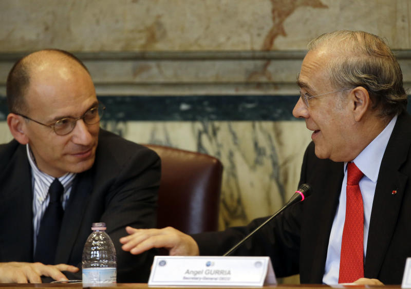 Angel Gurria, Secretary-General of the Organization for Economic Co-operation and Development (OECD), right, flanked by Italian Premier Enrico Letta, delivers his speech during the Economic Survey of Italy forum in Rome, Thursday, May 2, 2013.  (AP Photo/Gregorio Borgia)
