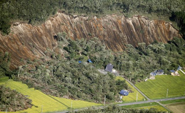 Houses damaged by a landslide caused by an earthquake, are seen in Atsuma town in Japan's northern island of Hokkaido, Japan, in this photo taken by Kyodo September 6, 2018. Mandatory credit Kyodo/via REUTERS ATTENTION EDITORS - THIS IMAGE WAS PROVIDED BY A THIRD PARTY. MANDATORY CREDIT. JAPAN OUT. NO COMMERCIAL OR EDITORIAL SALES IN JAPAN.