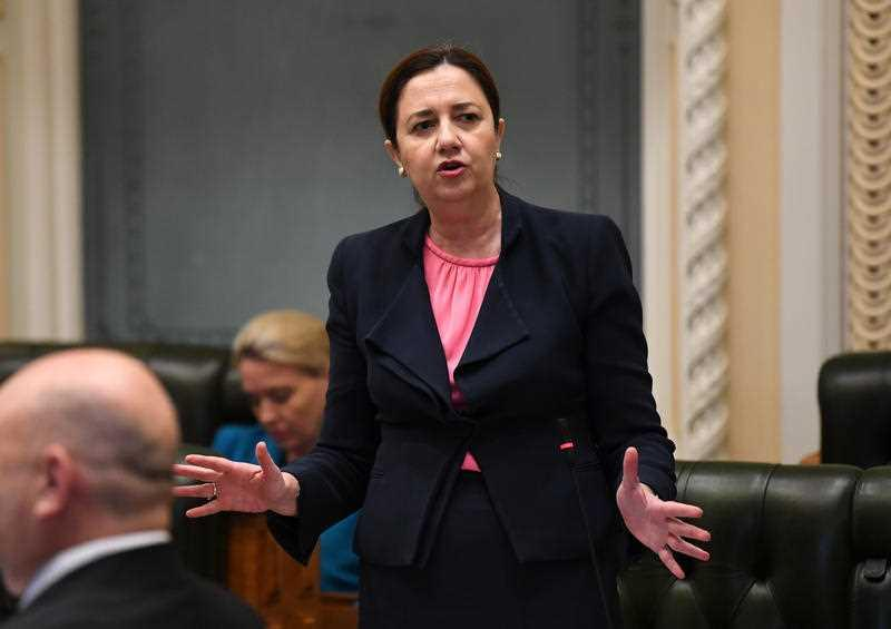 Queensland Premier Annastacia Palaszczuk addresses a reduced chamber, due to social distancing measures, during Question Time at Queensland Parliament in Brisbane.
