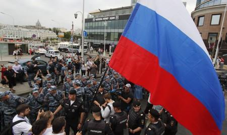 Law enforcement officers stand guard during a rally in support of Russian investigative journalist Ivan Golunov in Moscow