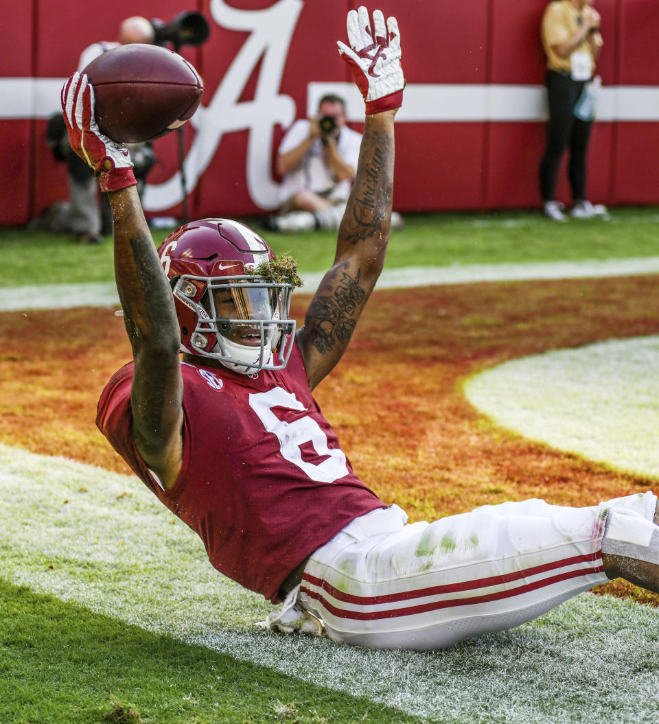 FILE - Alabama's DeVonta Smith (6) reacts after his third-quarter touchdown reception against Mississippi during an NCAA college football game in Tuscaloosa, Ala., in this Saturday, Sept. 28, 2019, file photo. DeVonta Smith is The Associated Press college football player of the year, becoming the first wide receiver to win the award since it was established in 1998, Tuesday, Dec. 29, 2020. (Bruce Newman/The Oxford Eagle via AP)