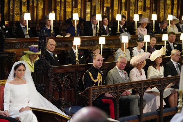 The Queen and Prince Philip are seen in the second row of the chapel.