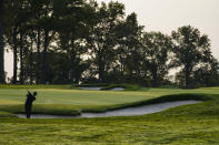 Tiger Woods hits from a bunker on the fifth fairway during practice before the U.S. Open Championship golf tournament at Winged Foot Golf Club, Wednesday, Sept. 16, 2020, in Mamaroneck, N.Y. (AP Photo/John Minchillo)