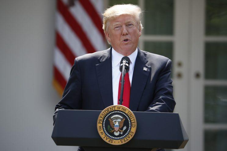 President Donald Trump speaks about the U.S. role in the Paris climate change accord, Thursday, June 1, 2017, in the Rose Garden of the White House in Washington. (Photo: Pablo Martinez Monsivais/AP)