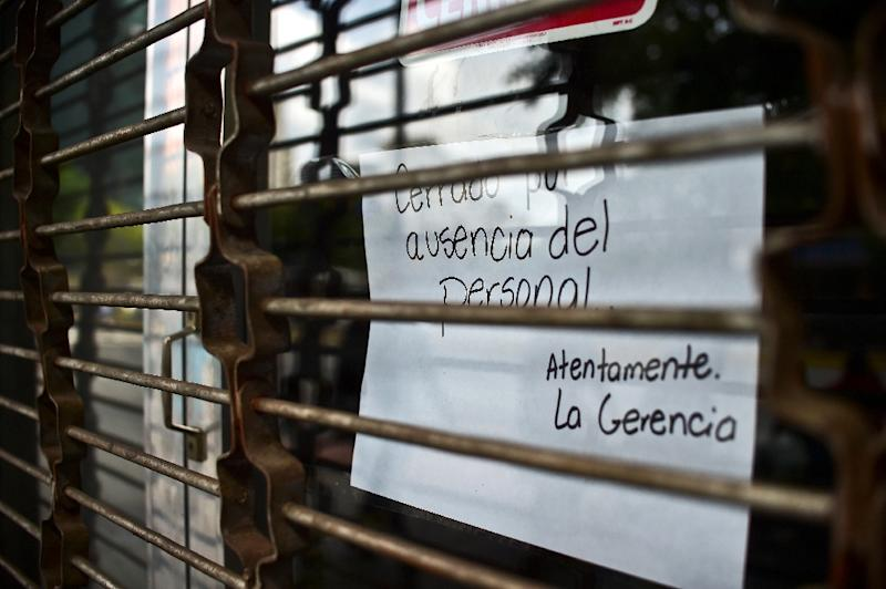 In Caracas the streets are quieter than normal but public transport was running and banks and some schools opened as usual (AFP Photo/Ronaldso Schemidt)