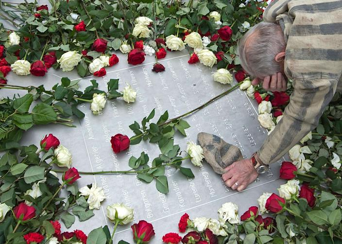 <p>Nazi concentration camp survivor Alexander Bytschok of Kiev, Ukraine, mourns at a metal plaque during the commemoration ceremonies for the 72th anniversary of the liberation of the former Nazi concentration camp Buchenwald near Weimar, Germany, Tuesday, April 11, 2017. (AP Photo/Jens Meyer) </p>