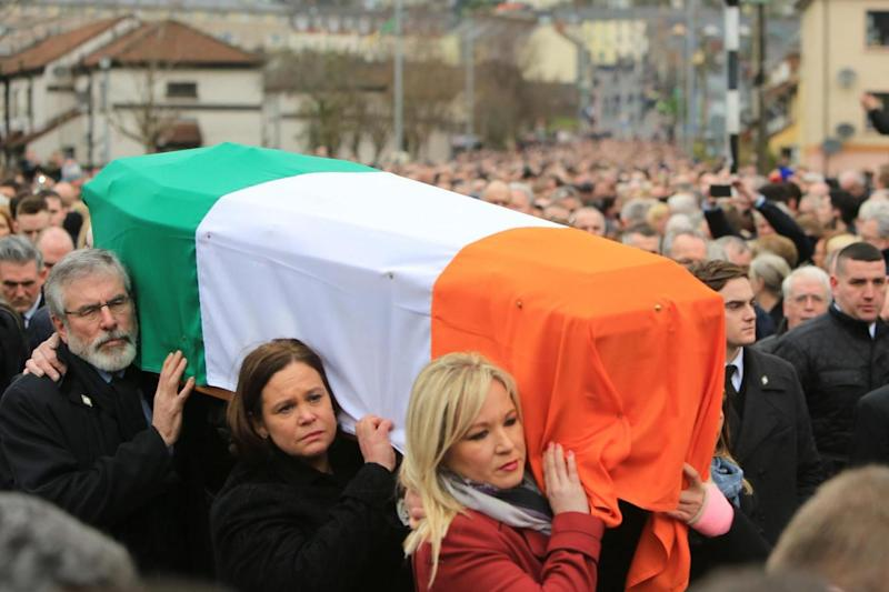 Procession: Gerry Adams carries the coffin with Mary Lou McDonald (C), Deputy Leader of Sinn and Michelle O'Neill (LNP)