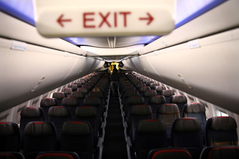 FILE PHOTO: Rows of empty seats of an American Airline flight are seen, as coronavirus disease (COVID-19) disruption continues across the global industry, during a flight between Washington D.C. and Miami, in Washington, U.S.